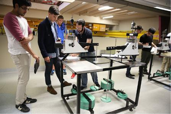 Image of students working with lab equipment