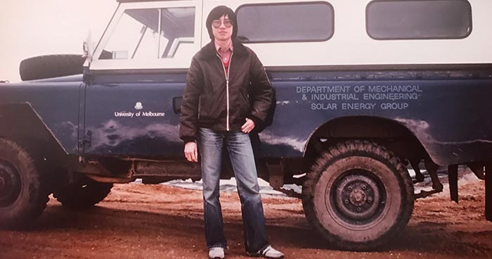 Stephen Ho during his university years standing in front of a truck