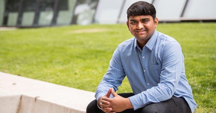 Sriram Chandrasekaran sitting outside Melbourne School of Design