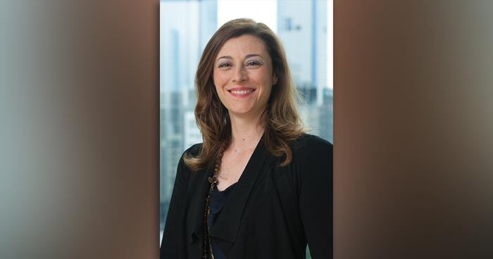 Headshot of Liza Maimone with skyscrapers in background