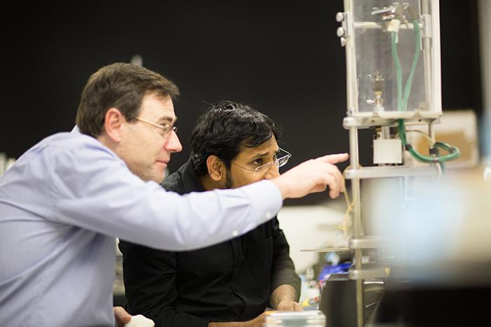 Professor David Grayden and Dr Sam John in a laboratory working on Stentrode