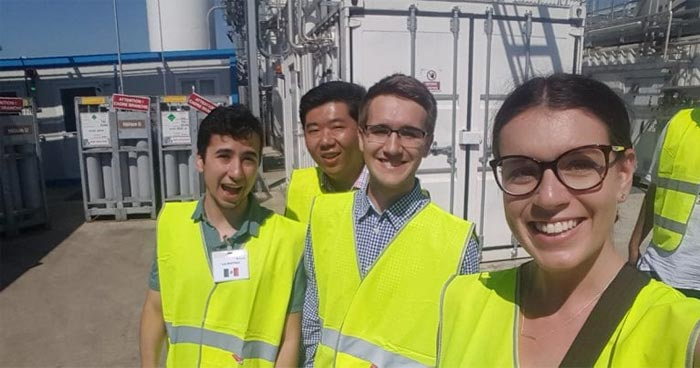 Molly Livingstone in hi-vis gear with fellow interns