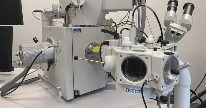Electron microscope with special viewing attachment in lab