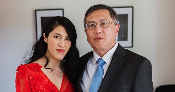 Stephen ho standing with daughter Tracy